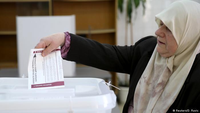 Woman voting in Bosnia