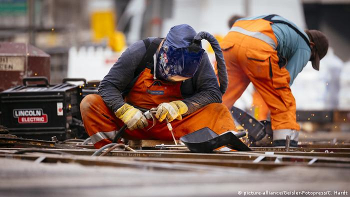 Workers fix train tracks in Cologne