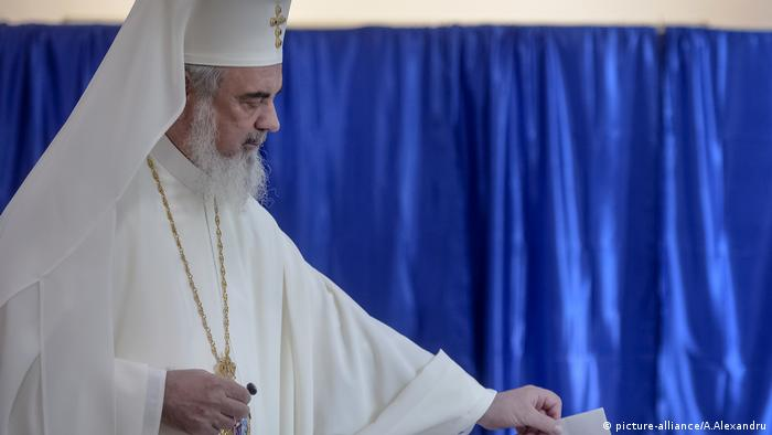 The head of the Romanian Orthodox Church, Patriarch Daniel, casts his vote in a referendum to ban gay marriage in Romania