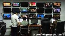 In this photograph taken on September 11, 2018 Afghan reporters of Tolo News work in the newsroom at Tolo TV station in Kabul. - Moments after Afghan journalist Samim Faramarz wrapped up his live report on the latest suicide attack in Kabul, a car bomb exploded just metres away, killing him and his cameraman Ramiz Ahmadi. Their colleagues at Tolo News choked back tears as they reported the deaths live on air -- cracking open a divisive debate on how Afghan journalists should operate in such a dangerous environment. (Photo by WAKIL KOHSAR / AFP) / To go with AFGHANISTAN-UNREST-MEDIA,FOCUS by Allison JACKSON (Photo credit should read WAKIL KOHSAR/AFP/Getty Images)