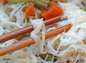 A dish of Chinese noodles with chopsticks