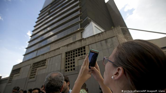 Manuela Bolivar, a lawmaker and member of the First Justice party, takes photos of the Bolivarian National Security Service (SEBIN) headquarters