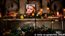 This picture taken on October 8, 2018, shows a portrait of slain Bulgarian television journalist Viktoria Marinova during in a candle-light vigil in the city of Rousse. - Corruption-plagued EU member Bulgaria found itself under pressure to find the killer of a television journalist whose brutal murder at the weekend has shocked the country and sparked international condemnation. (Photo by Dimitar DILKOFF / AFP) (Photo credit should read DIMITAR DILKOFF/AFP/Getty Images)