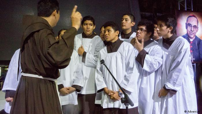 Altar boys take part in a vigil on the eve of Romero's beatification in 2015.