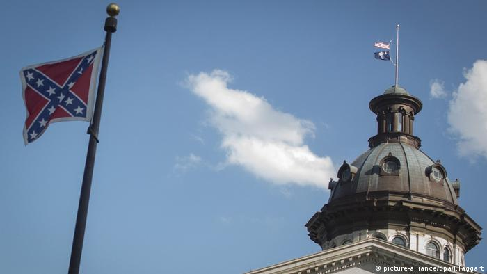 A file photo dated 20 June 2015 shows the Confederate flag at the South Carolina State House Building in Columbia, South Carolina.