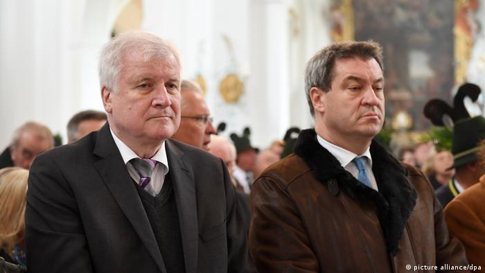 Horst Seehofer and Markus Söder standing side by side in 2018 at commemoration of Franz Josef Strauss
