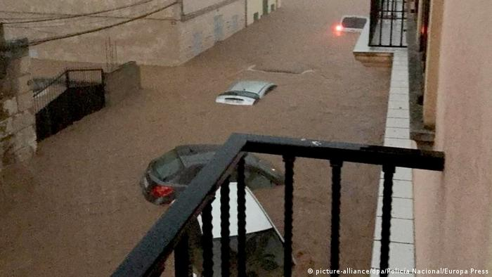 Dozens of cars submerged under water by flash floods