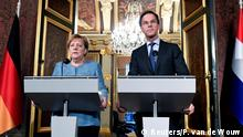 10.10.2018*** German Chancellor Angela Merkel and Dutch Prime Minister Mark Rutte hold a news conference in The Hague, the Netherlands October 10, 2018. REUTERS/Piroschka van de Wouw
