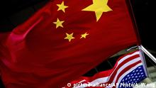 07.11.2012 FILE - In this Nov. 7, 2012, filephoto, U.S. and Chinese national flags are hung outside a hotel during the U.S. Presidential election event, organized by the U.S. embassy in Beijing. A government report is outlining how spy services from China, Russia and Iran are hard at work trying to steal trade secrets and proprietary information from U.S. companies, government labs and universities.(AP Photo/Andy Wong, File) |