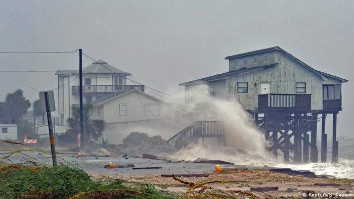 Waves hit houses on stilts due to Hurricane Michael (Reuters/S. Nesius)