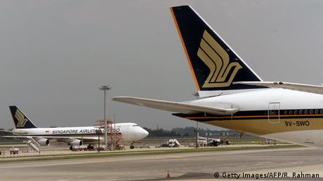 This photograph taken in September 2016 shows Singapore Airlines planes parked on the tarmac of Changi International Airport in Singapore