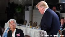 QUEBEC CITY, QC - JUNE 09: Christine Lagarde looks up at US President Donald Trump as he arrives late to the Gender Equality Advisory Council working breakfast on the second day of the G7 Summit on June 9, 2018 in Quebec City, Canada. Canada are hosting the leaders of the UK, Italy, the US, France, Germany and Japan for the two day summit, in the town of La Malbaie. (Photo by Leon Neal/Getty Images)