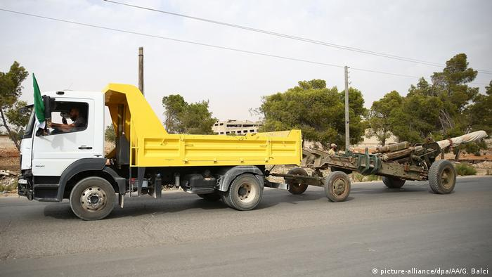 Truck pulling heavy weapon