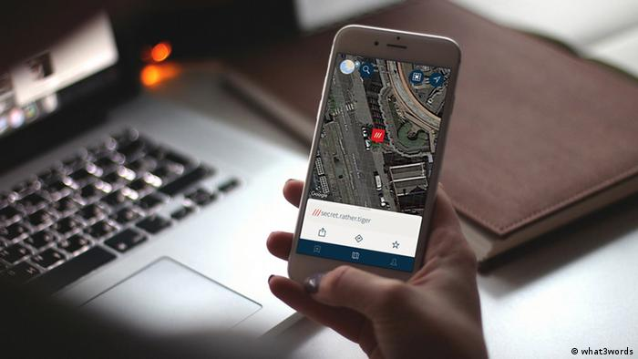 A what3words user looking for an address on her smartphone