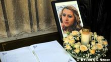 A photo of murdered Bulgarian journalist Viktoria Marinova sits next to a condolence book before her funeral service in Ruse (Reuters/S. Nenov)