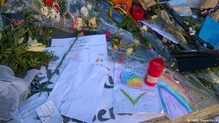Commemorative items, including children's drawings, make up the makeshift memorial in front of the Courts of Justice building in Valletta