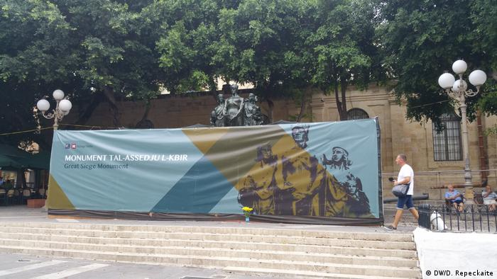 The Great Siege Monument is covered by a giant banner