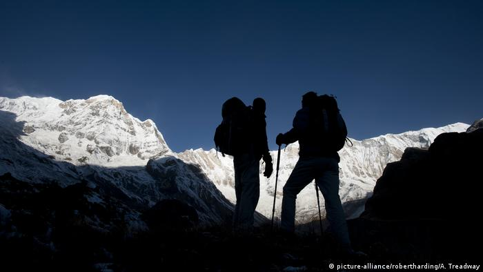 Silhouette of climbers in the Annapurna region