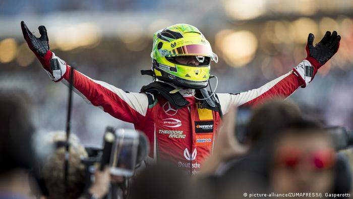 Mick Schumacher raises hands in celebration after securing the F3 title