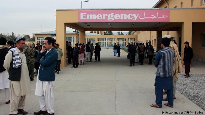 Relatives of bombing attack victims wait in front of Takhar hospital