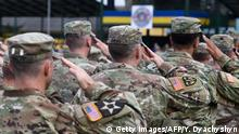 US soldiers take part in the opening ceremony of the Rapid Trident-2018 international military exercises in Starytchi, outside Lviv on September 3, 2018. - Ukraine launched joint military exercises with the United States and a string of other NATO countries as tensions with Russia remain high over the Kremlin-backed insurgency in the country's east. The annual Rapid Trident military exercises, takes plce until September 15, involving some 2,200 soldiers from 14 countries. (Photo by Yuri DYACHYSHYN / AFP) (Photo credit should read YURI DYACHYSHYN/AFP/Getty Images)