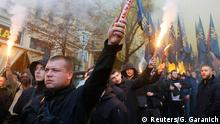 People, including Ukrainian nationalists and members of far-right radical groups,light flares during a procession to mark the Defender of Ukraine Day in Kiev, Ukraine October 14, 2018. REUTERS/Gleb Garanich