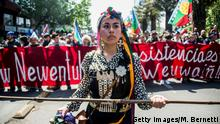 TOPSHOT - A Chilean Mapuche demonstrates in support of the Mapuche resistance in Santiago, on October 14, 2018. - Mapuches are Chile's largest indigenous group. (Photo by Martin BERNETTI / AFP) (Photo credit should read MARTIN BERNETTI/AFP/Getty Images)