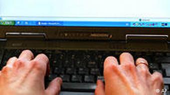 a pair of hands are seen typing on a laptop