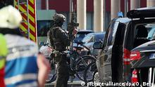 A police commando stands alert near Cologne's central station