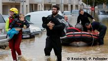 Rescuers evacuate residents after flash floods hit the Aude district of France (Reuters/J.-P. Pelissier)