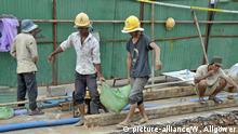 Symbolbild: Bauarbeiter (Gebäude) in Kambodscha
