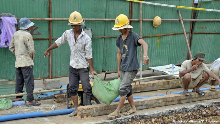 Construction workers at a building site in Siem Reap, in Cambodia