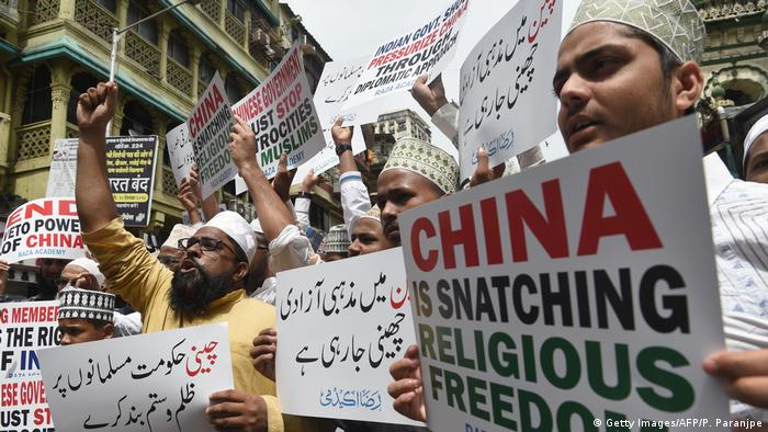 Indian Muslims hold placards during a protest against the Chinese government over the detention of Muslim minorities in Xinjiang