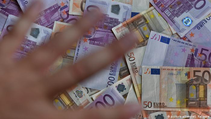 Euro notes, and a hand