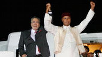 Abdelbaset al-Megrahi welcomed in Tripoli by the son of the Libyan leader, Seif al-Islam Gadhafi on August 20, 2009