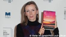 British author Anna Burns holds her book 'Milkman' during a photocall at the Royal Festival Hall in London on October 14, 2018, ahead of Tuesday's announcement of the winner of the 2018 Man Booker Prize for Fiction. (Photo by Daniel LEAL-OLIVAS / AFP) (Photo credit should read DANIEL LEAL-OLIVAS/AFP/Getty Images)