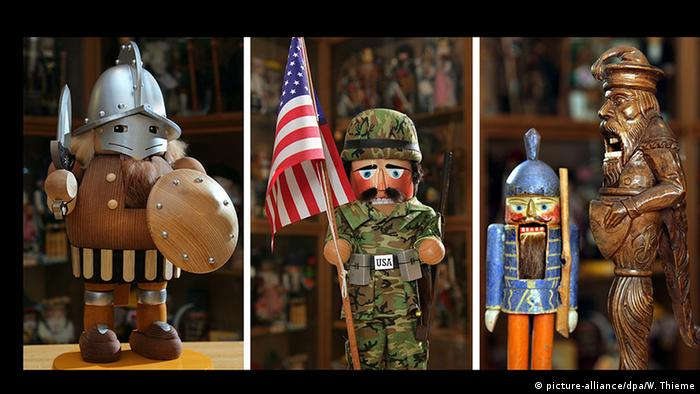 Three models of nutcrackers: Swiss knight (l) from circa 1650; a recent model depicting an American soldier; one of the first typical Ore Mountain region models from 1870. (picture-alliance/dpa/W. Thieme)