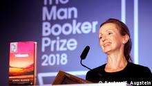 Writer Anna Burns smiles after she was presented with the Man Booker Prize for Fiction 2018 by Britain's Camilla, the Duchess of Cornwall during the prize's 50th year at the Guildhall in London, Britain, October 16, 2018. Frank Augstein/Pool via REUTERS
