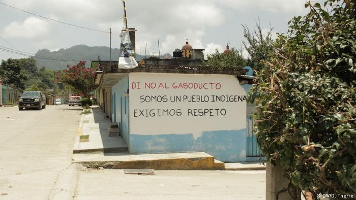 A painted wall in a Mexican village reads No to the gas pipeline, we're an indigenous community and demand respect.