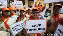 Women hold placards as they attend a protest rally called by various Hindu organisations against the lifting of ban by Supreme Court that allowed entry of women of menstruating age to the Sabarimala temple, in Ahmedabad, India, October 14, 2018. REUTERS/Amit Dave