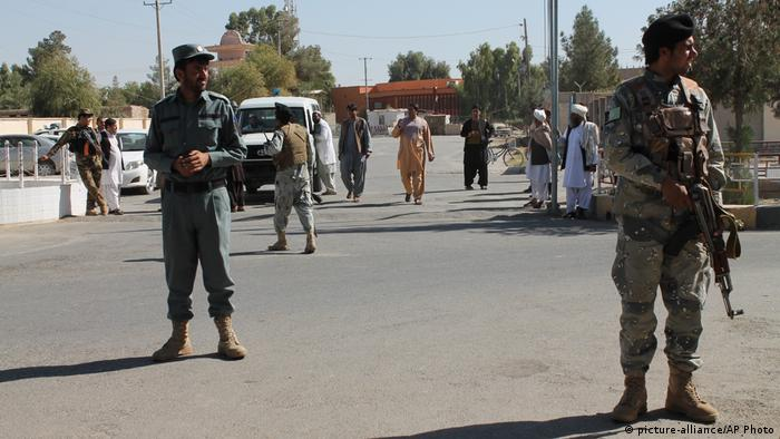 Afghan soldiers on the streets after an attack in Helmand province