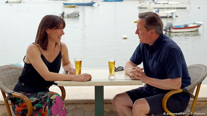 David Cameron sitting with his wife on holiday in Cornwall