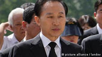 South Korean President Lee Myung Bak signs agreement after a year of negotiations
