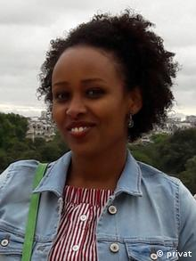 Fitsum Assefa Adela smile at the camera. The German city of Giessen is in the background