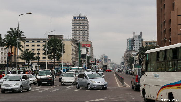 Traffic in Kinshasa with high-rise buildings in the background
