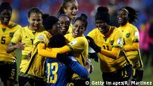 17.10.2018 FRISCO, TX - OCTOBER 17: Sheyla Diaz #16 celebrates her game winning goal with goalkeeper, Onelys Alvarado #13 of Jamaica during the CONCACAF Women's Championship third place match at Toyota Stadium on October 17, 2018 in Frisco, Texas. (Photo by Ronald Martinez/Getty Images)