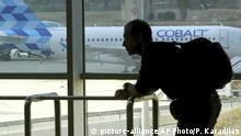 Seen from the airport building, a Cobalt aircraft sits at Larnaca international airport in Cyprus, Thursday, Oct. 18, 2018. Cyprus-based airline Cobalt Air says it has indefinitely suspended all of its operations, Thursday, amid a struggle to find investors. (AP Photo/Petros Karadjias)  