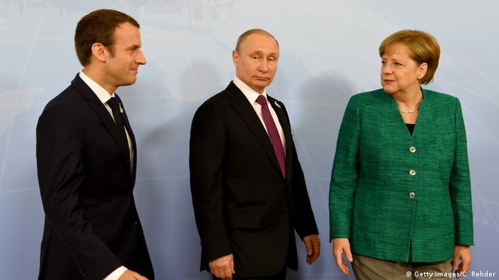 Macron, Putin und Merkel (v. l., Archivbild)
