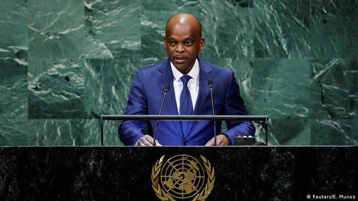 Togo's Foreign Minister Robert Dussey stands at a podium while giving a speech at the United Nations