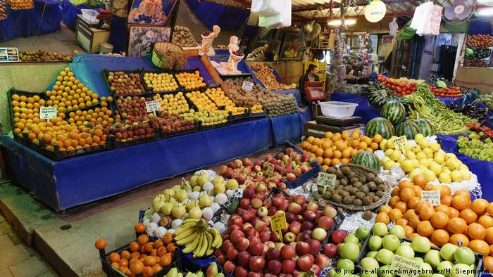 A fruit and vegetable stand at a market in Ayvalik